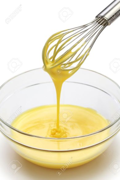 31037012-whisking-egg-yolks-and-sugar-in-a-bowl-making-custard-cream-process-Stock-Photo